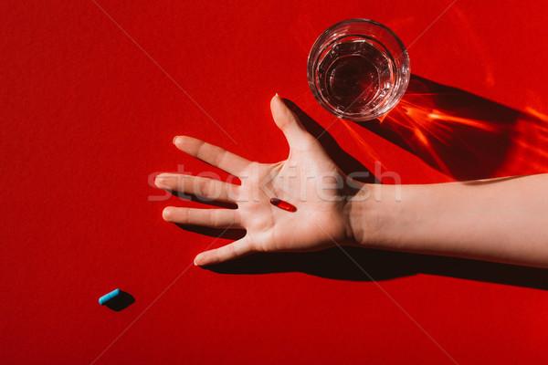 Kapszula kéz felső kilátás piros emberi kéz Stock fotó © LightFieldStudios