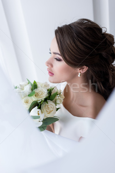 Stock photo: young brunette bride holding wedding bouquet