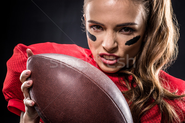 Stock photo: American football player holding ball