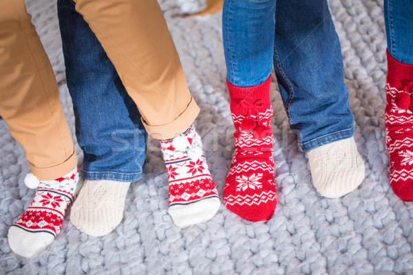 Female feet in knitted socks Stock photo © LightFieldStudios