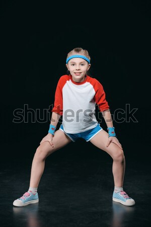 girl training with dumbbells isolated on black. activities for children concept Stock photo © LightFieldStudios