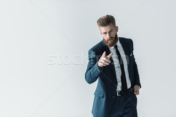Handsome bearded businessman in stylish suit pointing at camera with finger Stock photo © LightFieldStudios