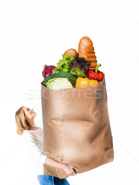 woman with huge paper bag Stock photo © LightFieldStudios