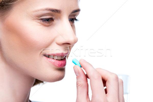 таблетки привлекательный улыбающаяся женщина изолированный белый Сток-фото © LightFieldStudios