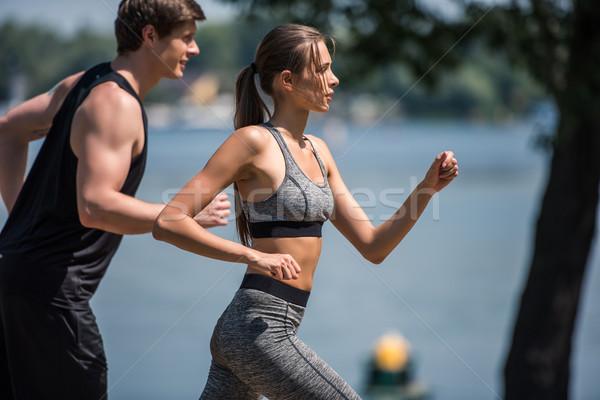 sportive couple jogging in park Stock photo © LightFieldStudios