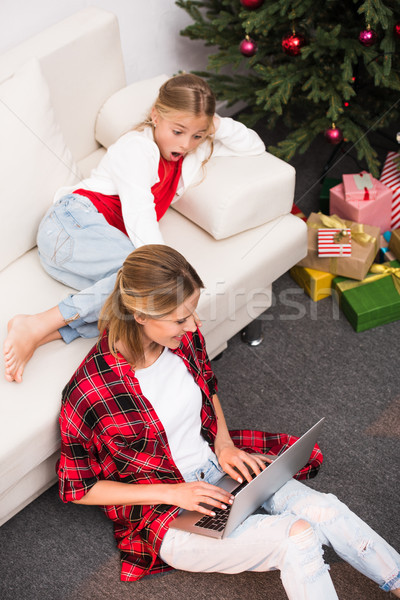 mother and daughter with laptop Stock photo © LightFieldStudios