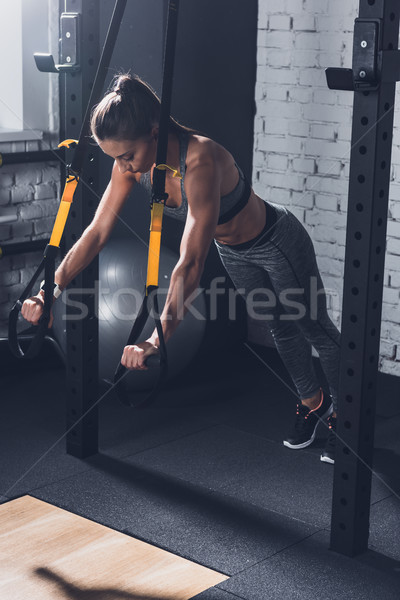 woman doing TRX Suspension Training Stock photo © LightFieldStudios