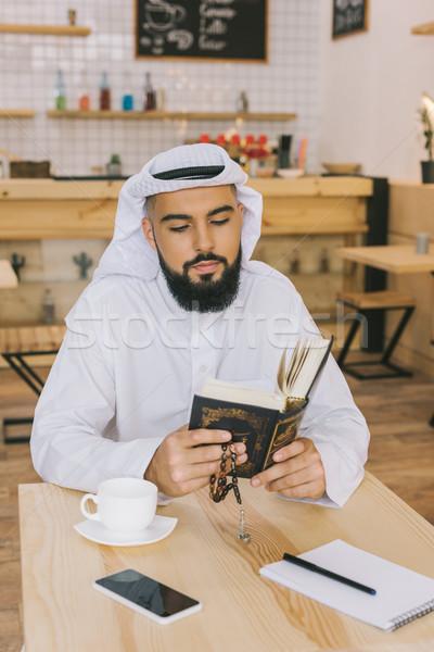 muslim man reading quran Stock photo © LightFieldStudios