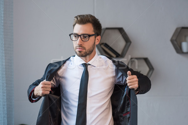 Affaires blazer jeunes élégant verres Photo stock © LightFieldStudios