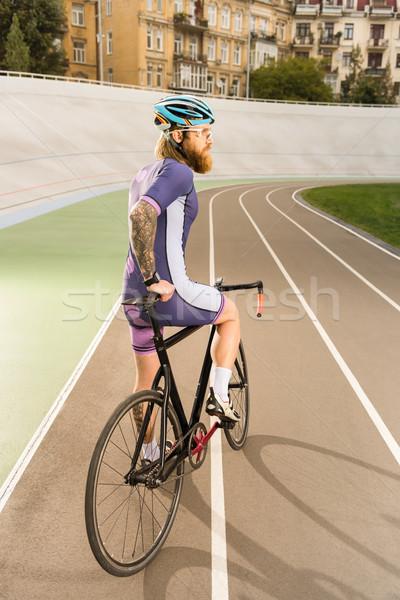 Bisikletçi devir yarış pisti arkadan görünüm kask Stok fotoğraf © LightFieldStudios