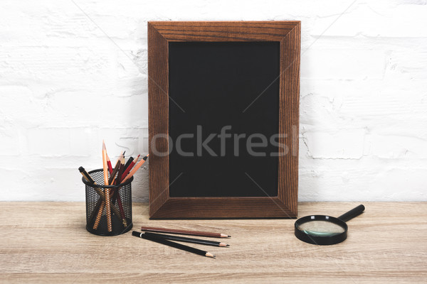 photo frame and office supplies on table Stock photo © LightFieldStudios
