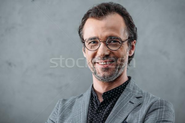 Elegancki w średnim wieku biznesmen przystojny okulary uśmiechnięty Zdjęcia stock © LightFieldStudios