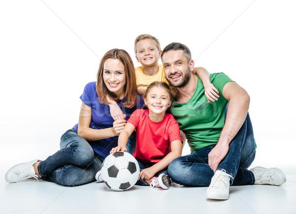 счастливая семья футбольным мячом сидят вместе белый Сток-фото © LightFieldStudios