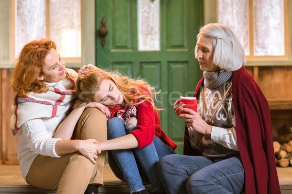 Family drinking hot tea on stairs Stock photo © LightFieldStudios