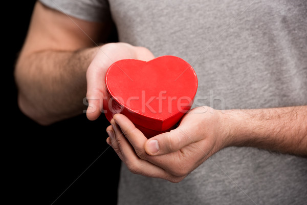 partial view of man showing heart in hands on black, international womens day concept Stock photo © LightFieldStudios