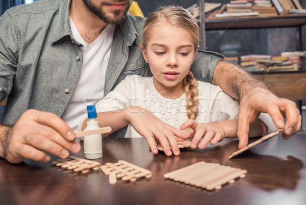 Father and daughter making figure Stock photo © LightFieldStudios