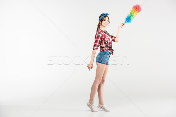 Young woman with duster Stock photo © LightFieldStudios