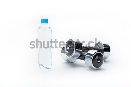 metallic dumbbells, bottle, measuring tape and towel isolated on white. equipment sport and healthy  Stock photo © LightFieldStudios