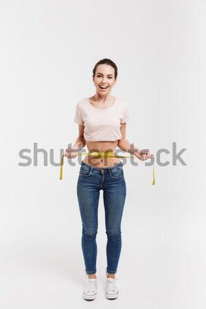 Femme pointant blanche tshirt belle femme isolé Photo stock © LightFieldStudios