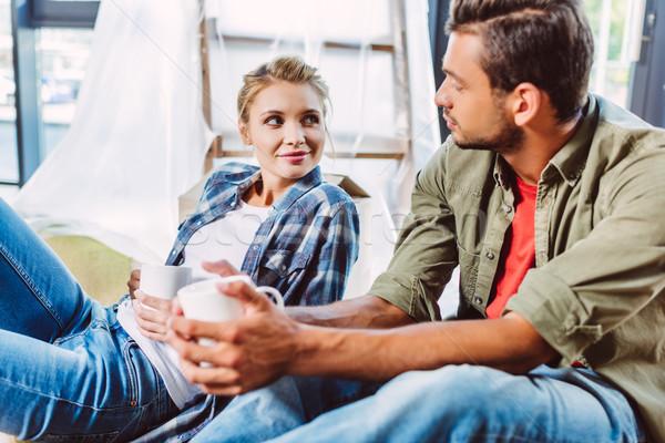 Stock photo: couple drinking tea in new apartment