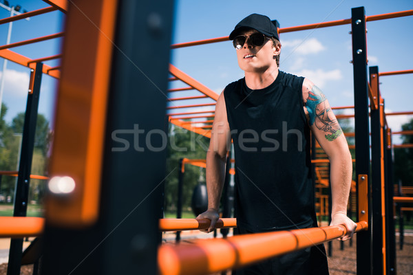 Stock photo: man exercising on sports ground
