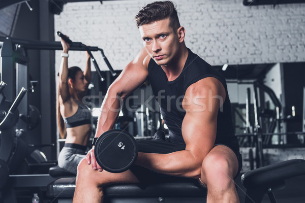 athletic man with barbell Stock photo © LightFieldStudios