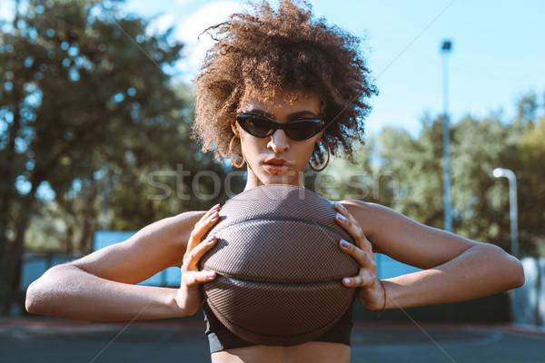 Vrouw basketbal jonge zonnebril borst Stockfoto © LightFieldStudios