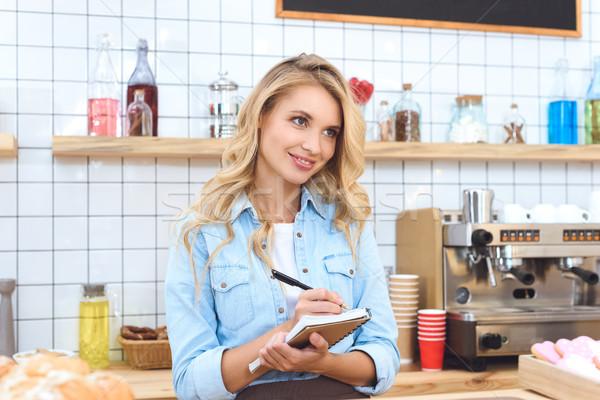 cafe owner taking notes Stock photo © LightFieldStudios