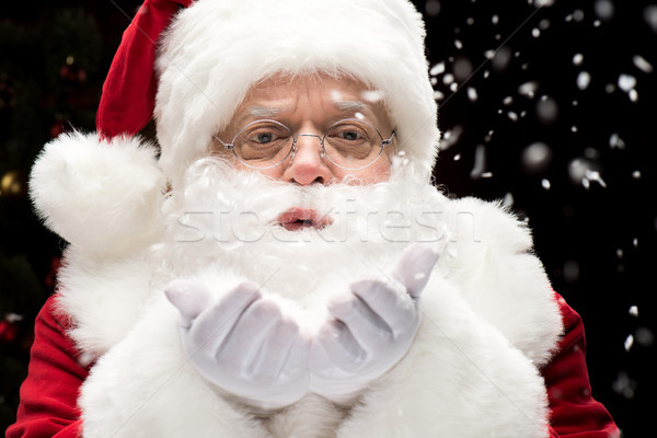 Stock photo: Santa Claus blowing snowflakes