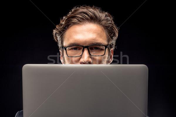 Işadamı dizüstü bilgisayar kullanıyorsanız görmek yakışıklı gözlük Stok fotoğraf © LightFieldStudios