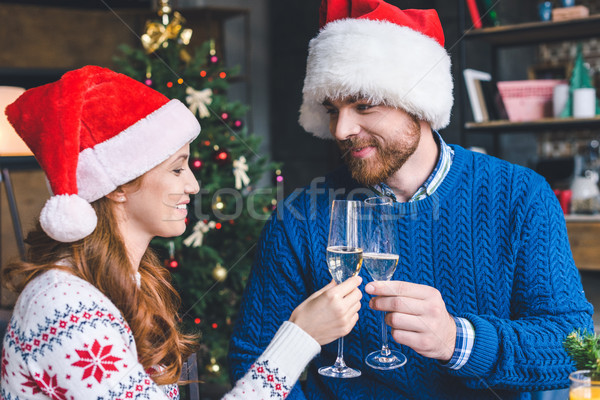 couple clinking champagne glasses on christmas Stock photo © LightFieldStudios