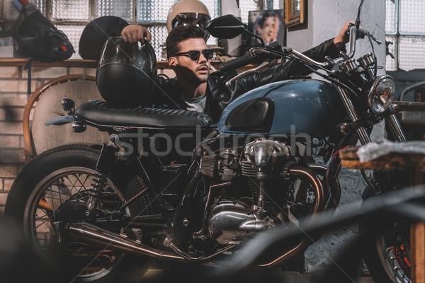 Motoros klasszikus motorkerékpár fiatal jóképű napszemüveg Stock fotó © LightFieldStudios