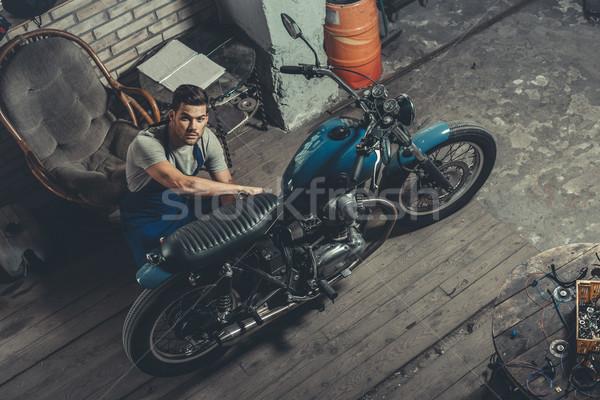 mechanic with motorbike in garage Stock photo © LightFieldStudios