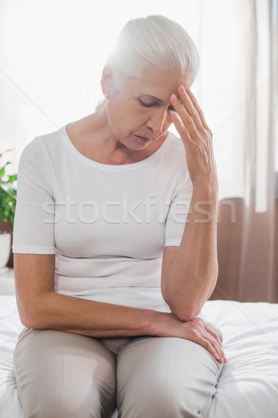 upset senior woman in hospital Stock photo © LightFieldStudios