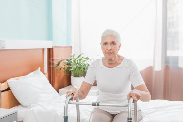 senior woman with walker in hospital Stock photo © LightFieldStudios
