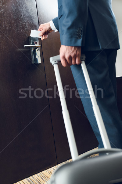 Biznesmen walizkę otwarcie drzwi shot garnitur Zdjęcia stock © LightFieldStudios