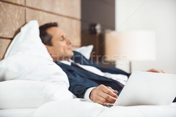 Empresário quarto de hotel formal terno queda Foto stock © LightFieldStudios