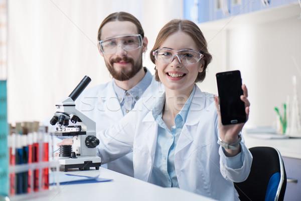 Feminino cientista tela trabalhando Foto stock © LightFieldStudios