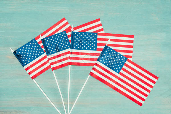 flat lay with arranged american flags on blue wooden surface, presidents day concept Stock photo © LightFieldStudios