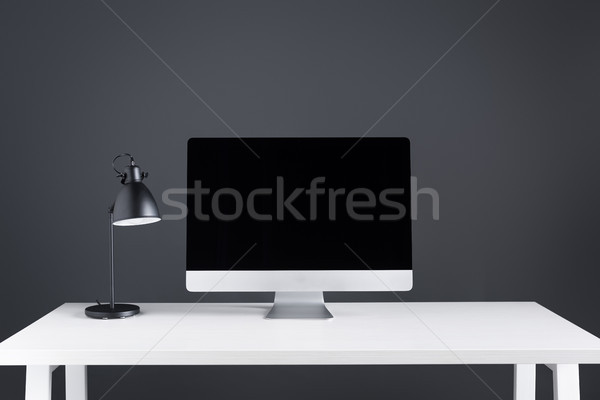modern desktop computer with blank screen and lamp on table at workspace Stock photo © LightFieldStudios