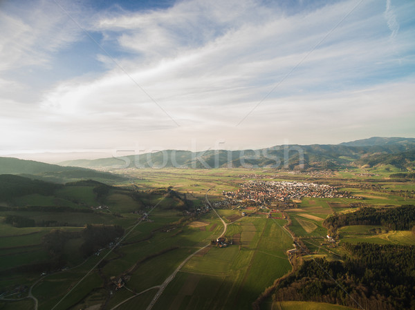 Aerial view of majestic landscape with field, hills and town in Germany Stock photo © LightFieldStudios