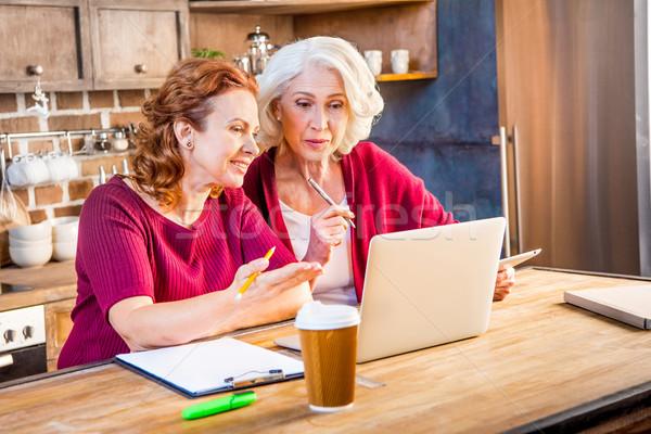 Women using laptop Stock photo © LightFieldStudios