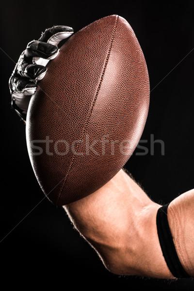 Futballista tart labda kilátás izmos rögbilabda Stock fotó © LightFieldStudios