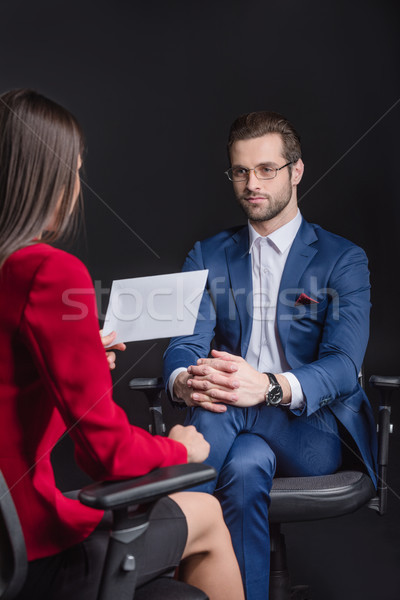 Woman interviewing man Stock photo © LightFieldStudios