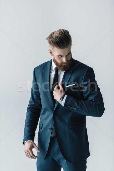 şık yakışıklı sakallı işadamı bakıyor takım elbise Stok fotoğraf © LightFieldStudios
