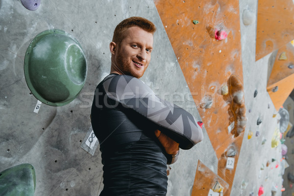 young man with arms crossed at gym Stock photo © LightFieldStudios