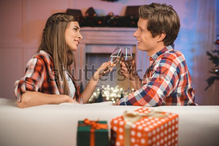 Homme cadeau petite amie Noël vue de côté Photo stock © LightFieldStudios