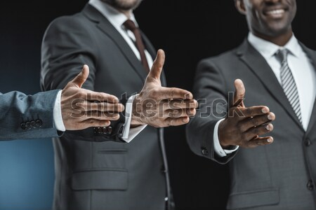 Businessman adjusting tie  Stock photo © LightFieldStudios