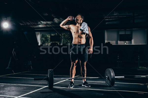 Fit sportsman drinking water Stock photo © LightFieldStudios