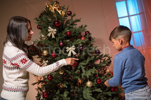 mother and son decorating christmas tree Stock photo © LightFieldStudios